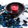 Red candle and a blue potpourri — Stock Photo