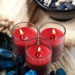 Foto Stock: Three red candles