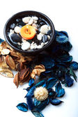 Orange candle with potpourri — Stockfoto