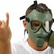 Man in gas mask showing sign — Stock Photo