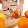 Orange cutting on a wooden plate — Stock Photo