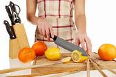 Girl cutting lemon in slices 2 — Stock Photo
