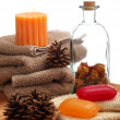 Soaps, towels and pine cones — Stock Photo
