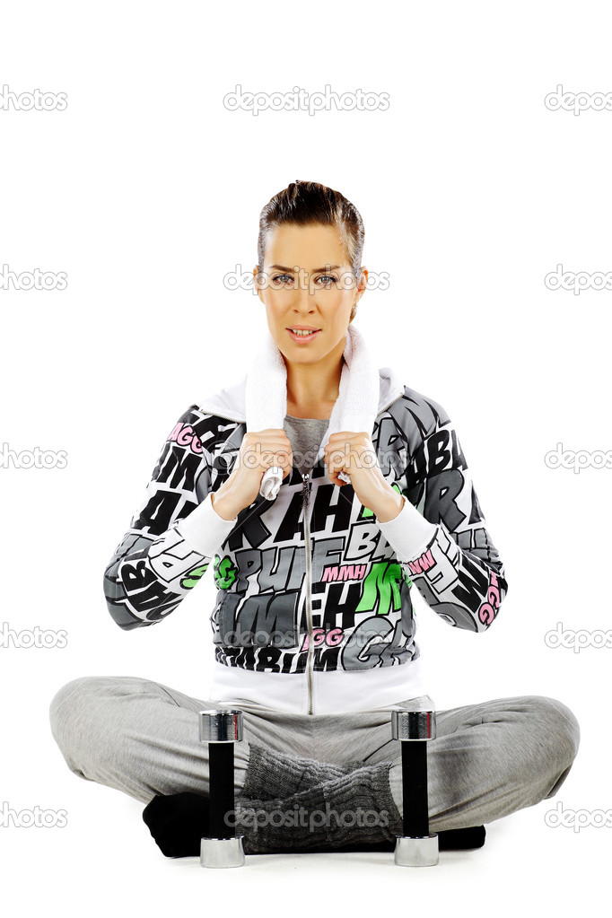 Girl sitting and relaxing after workout with weights, on a white background — Stock Photo #5342604