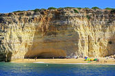 Beach, cliff and grotto at Carvoeiro — Stock Photo