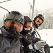 Stock Photo: Father and kids on chair lift