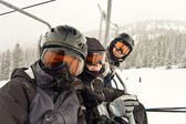 Father and kids on a chair lift — Stock Photo