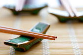 Chopsticks on table matt — Stock Photo