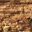 Uneven and old brick wall — Stock Photo
