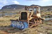 The thrown bulldozer in mountains — Stock Photo