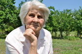 An elderly woman, thought — Stock Photo