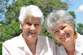Two elderly women laugh — Stock Photo
