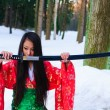 Girl with a katana - Stock Photo