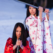 Stock Photo: Beautiful brunette girls in a japanese kimono