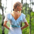Young girl in a blue dress in the park — Stock Photo