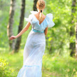 Young girl in a blue dress in the park — Stock Photo #4308677