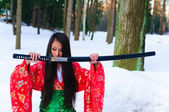 Girl with a katana — Stockfoto
