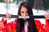 Girl with a katana — Stock Photo