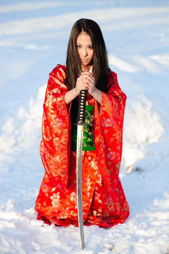 Girl with a katana — Stock Photo © evdoha #4300113