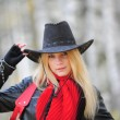 Girl in a black cowboy hat — Stock Photo