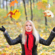 The girl throws leaves — Stock Photo #4329661