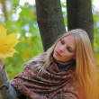 Girl with autumn maple leaves — Stock Photo #4332545