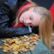 Young beautiful girl in autumn background — Stock Photo