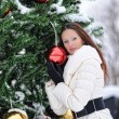 Girl standing next to the Christmas tree — Stock Photo