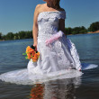 Girl in a wedding dress in water — Foto Stock