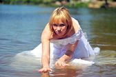 Girl in a wedding dress in water — Stock Photo