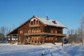Wooden Russian house in winter covered with snow — Stock Photo