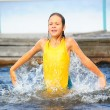 The little girl splashing with water — Stock Photo #4455066