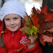 Little girl in an autumn park — Stock Photo #4456503