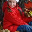 Little girl in an autumn park — Stock Photo #4456525
