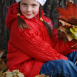 Little girl in an autumn park — Stock Photo