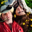 Happy couple lying on a grass — Stock Photo