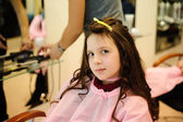 The little girl doing a hairdress — Stock Photo
