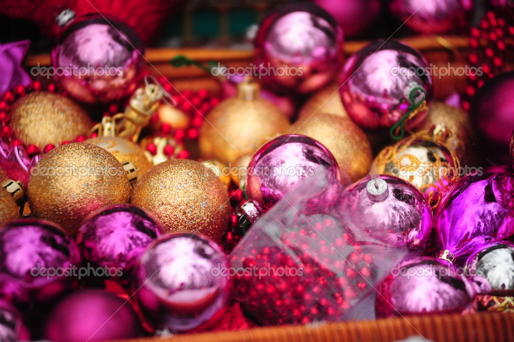Christmas background with gold and purple beads — Stock Photo #4555290