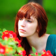 Woman in garden of roses — Stock Photo #4562941