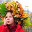 The little girl with a wreath from autumn leaves — Stock Photo