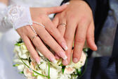 Hands of the newlyweds — Stock Photo