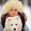 Girl with a Samoyed — Stock Photo