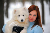 Girl with a puppy Samoyed — Stock Photo