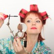 Housewife with a magniglass — Stockfoto