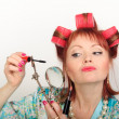 Housewife with a magniglass — Stock Photo #4655407
