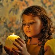 Candlelight portrait of beautiful little girl - Stock Photo