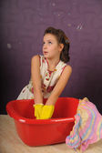 Housewife wash clothes — Stock Photo