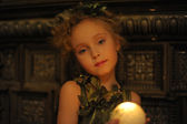 Candlelight portrait of beautiful little girl — Stock Photo