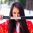 Stock Photo: Girl with katana