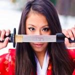 Girl with a katana — Stock Photo #4940181